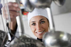 Chef. Mid adult female chef taking kitchen utensil stock photos