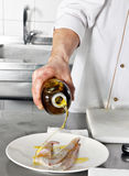 Chef add oil Royalty Free Stock Photo