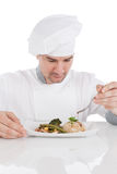 Chef add sauce to prepared food Royalty Free Stock Images