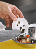 Chef added spice Royalty Free Stock Photos