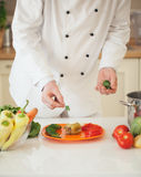 Chef Adding Parsley to a Stuffed Pepper Royalty Free Stock Photo