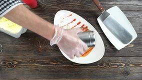 Chef adding powdered sugar. Apple tart on wooden table stock footage