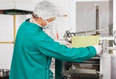 Chef Adjusting Pasta Sheet In Machine Royalty Free Stock Photo
