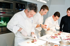 Chef Andrea Canton and his sous chefs Stock Photography