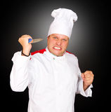 Chef  angry and swinging knife in the air. Young chef  angry and swinging knife in the air Stock Photography