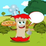 Chef apple core with pizza showing thumb up on a meadow with speech bubble Stock Photo
