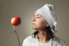 Chef with apple and fork Stock Image
