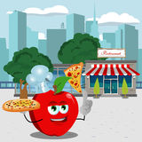 Chef apple holding pizza with attitude in front of a restaurant Royalty Free Stock Images