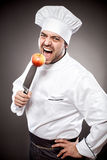 Chef with apple on knife Royalty Free Stock Image