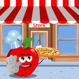 Chef apple with pizza holding a stop sign in front of a storefront Stock Photography