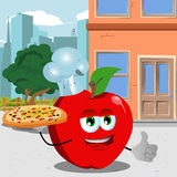 Chef apple with pizza showing thumb up in the city Stock Image