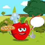Chef apple with pizza showing thumb up on a meadow with speech bubble Royalty Free Stock Images