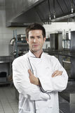 Chef With Arms Crossed In Kitchen Royalty Free Stock Image