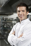 Chef With Arms Crossed In Kitchen Stock Image