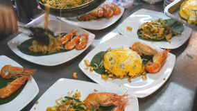 Chef arrange pad thai with fried egg and shrimp in white plate. Chef arrange pad thai with fried egg and shrimp on banana leaf in white plate stock video