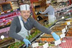Chef arranging trays food Stock Photos