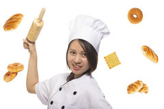 Chef Asian woman holding baking rolling pin wearing uniform and Royalty Free Stock Images