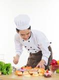 Chef asiatique préparant des nourritures Photos libres de droits