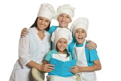 Chef with assistants. Happy female chef with assistants isolated on a white background stock photos