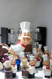 Chef and assistants. Chef walking random among the toy jinn or his assistants as if frightened of something Royalty Free Stock Photo