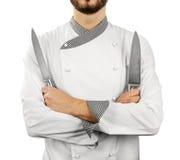 Chef avec des couteaux d'isolement sur le blanc photo libre de droits
