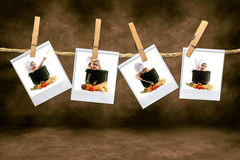 Chef Babies on Polaroid Film Hanging in a Dark Roo Stock Image