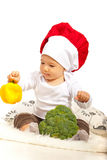 Chef baby with bell pepper Stock Photos