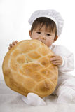 Chef baby with bread Stock Photo