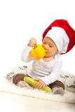 Chef baby eating bell pepper Stock Images