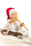 Chef baby eating wooden utensils Stock Photos