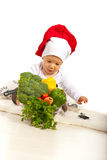 Chef baby with many vegetables Royalty Free Stock Photography