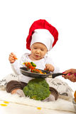 Chef baby taking macaroni Royalty Free Stock Image