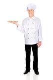 Chef baker with italian pizza Stock Photos