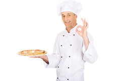Chef baker with italian pizza showing perfect sign Stock Photo