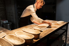Chef or baker making dough at bakery. Food cooking, baking and people concept - chef or baker making dough at bakery kitchen Stock Image