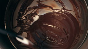 Chef baker mixing sweet delicious organic melted chocolate in bowl stock footage