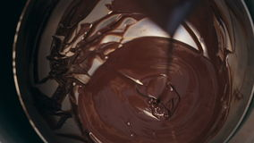 Chef baker mixing sweet delicious organic melted chocolate in bowl stock video footage