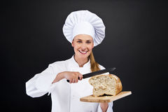 Chef baker smailing, fresh baked bread. Stock Image
