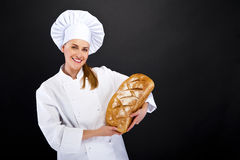 Chef baker smelling baked bread. Royalty Free Stock Photo