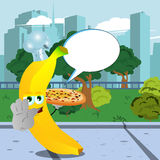 Chef banana with pizza holding a stop sign in the city park with speech bubble Stock Photos
