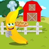 Chef banana with pizza pointing at viewer on a farm Royalty Free Stock Photography