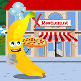 Chef banana with pizza pointing at viewer in front of a restaurant Stock Images