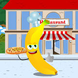 Chef banana with pizza showing thumb up in front of a restaurant Stock Photo