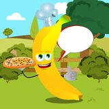 Chef banana with pizza showing thumb up on a meadow with speech bubble Royalty Free Stock Images