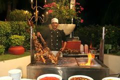 Chef at barbecue dinner Royalty Free Stock Photography