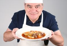 Chef with Beef Stew Stock Photography