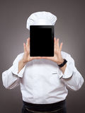 Chef behind the digital tablet Royalty Free Stock Image