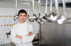 Chef behind ladles Royalty Free Stock Images
