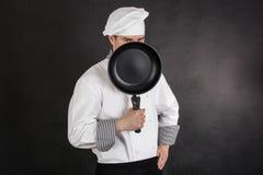 Chef behind pan Stock Image