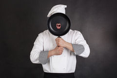 Chef behind pan Stock Image